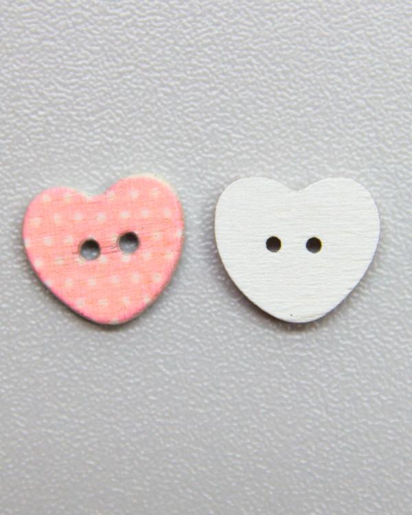 Knapp rosavitprick hjärta