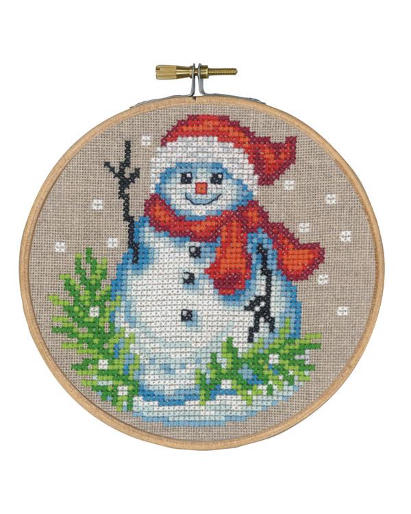 Kirjontapakkaus Taulu Lumiukko